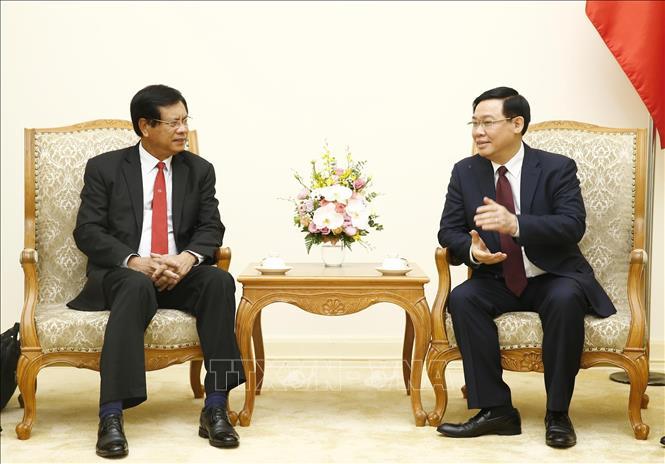 Việt Nam sẵn sàng chia sẻ kinh nghiệm đổi mới mô hình kinh tế với Lào