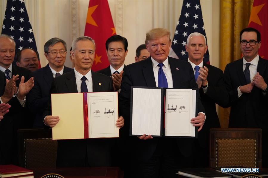 """Mỹ, Trung ký kết thỏa thuận thương mại """"giai đoạn 1"""""""