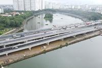 Hướng các phương tiện lưu thông cầu vượt thấp qua hồ Linh Đàm